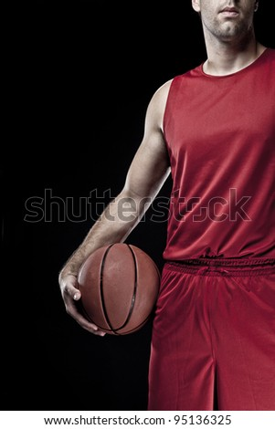 Basketball player with a ball in his hands