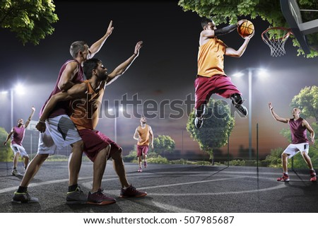 Basketball players in action on court #507985687