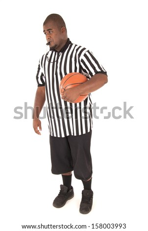 Basketball referee with basketball blowing the whistle