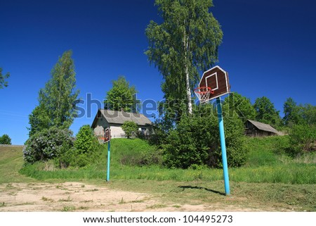 basketball ring on rural atheletic stadium