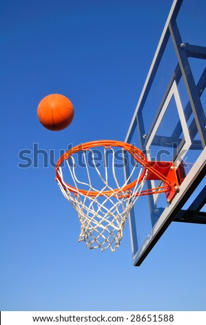 Basketball Shot Heading Toward the Hoop, Blue Sky, vertical, copy space