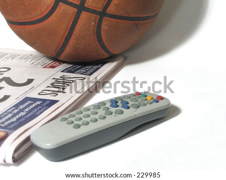 Basketball, sports section and TV remote