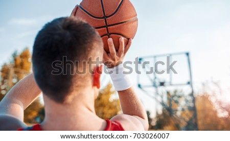 Basketball. Young basketball player exercising on the court. Sport, recreation concept