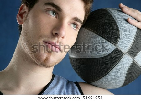 basketball young man basket player portrait over blue studio background