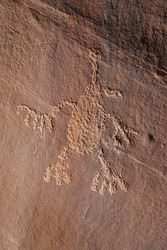Basketmaker Petroglyphs of an alien carved into a rock wall in Indian Creek, Utah.