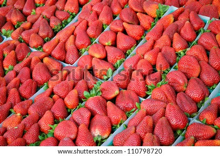Baskets of strawberries at a farmers' market