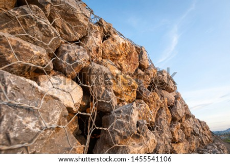 baskets stone dam prevent the destruction of earth and rock beside the high way  #1455541106