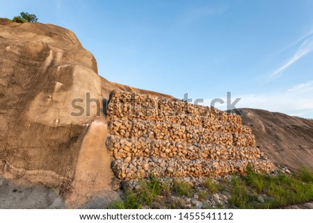 baskets stone dam prevent the destruction of earth and rock beside the high way  #1455541112