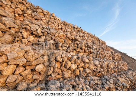 baskets stone dam prevent the destruction of earth and rock beside the high way  #1455541118