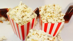 baskets with popcorn on a white  background. Two baskets of popcorn. Background for cinemas. Watching a movie with popcorn