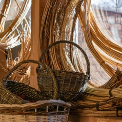 Baskets woven from willow twigs. Dishes for collecting mushrooms, apples and vegetables.