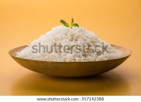 basmati rice in a brass bowl, cooked basmati rice, cooked plain rice, cooked white basmati rice, steamed basmati rice