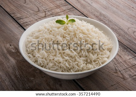 basmati rice in a brass bowl, cooked basmati rice, cooked plain rice, cooked white basmati rice, steamed basmati rice served in white bowl over wooden background