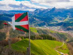 Basque country flag Txindoki mountain on sunny day