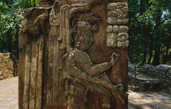 Basrelief carving of Mayan king and signs at the archaeological site of Palenque, Chiapas, Mexico