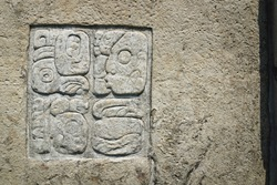 Basrelief carving of Mayan signs on palace wall at the archaeological site of Palenque, Chiapas, Mexico