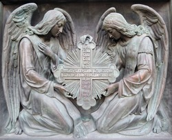 Basrelief on a cathedral in Saint-Petersburg. Two angels hold cross.