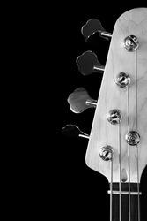 bass guitar headstock, black & white filter + isolated on black