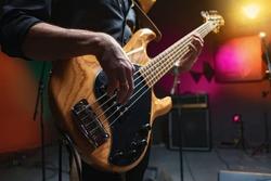 bass guitar in hands of musician