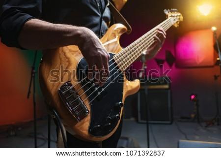 bass guitar in hands of musician Foto d'archivio ©