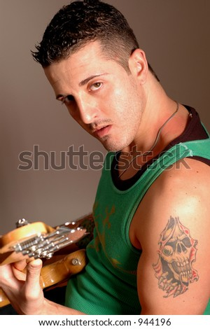 bass player with skull tattoo model