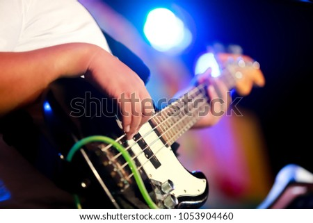Bassist playing electric bass guitar, live music theme