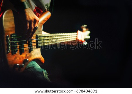 Bassist pop rock during a performance at a concert.