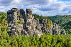 Bastei Rocks in Swiss Saxony, beautiful landscape scenery around the ruins of Neurathen Castle, Elbe Sandstone Mountains in Saxon Switzerland, Germany, Europe.