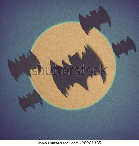 bat and full moon in Halloween day made by grunge recycle paper.
