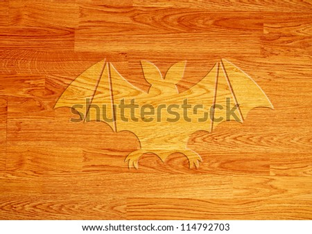 Bat icon on wood background