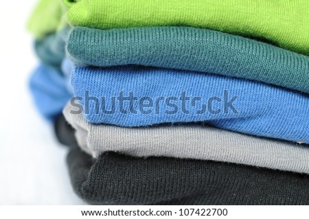 Batch of colorful clothes, folded up washing