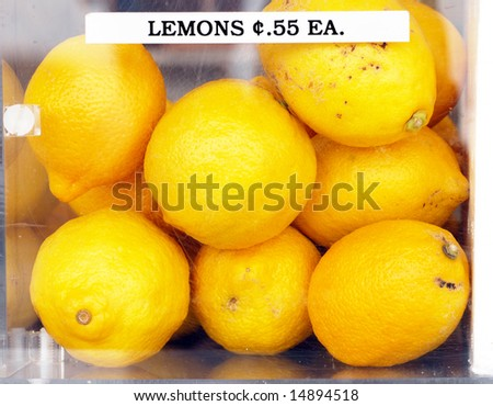 Batch of fresh lemons for sale at a market - stock photo