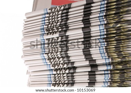 Batch of Newspapers isolated on white