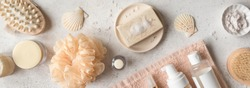 Bath Accessories on white stone background, top view, banner. Daily bodycare concept, organic bath products.