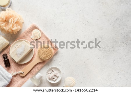 Bath Accessories on white stone background, top view, copy space. Daily bodycare concept, organic bath products.