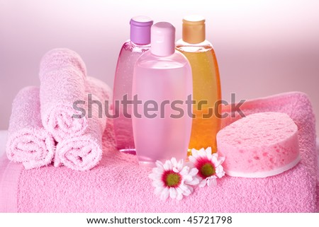 Bath care objects. Olive, shampoo, gel, towels