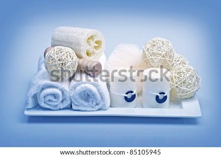 Bath Decoration & Relaxation Kit. Fresh Clean White Towels, Candles and Decorative Elements. Bath Deco. Blue Tones Horizontal Studio Photo.