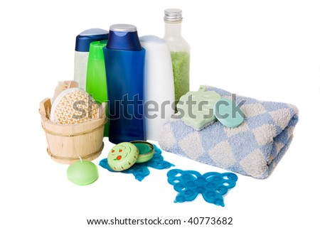 bath items including sponge, salt and shapoo over white