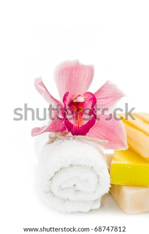 bath items with orchid soap towel and soap