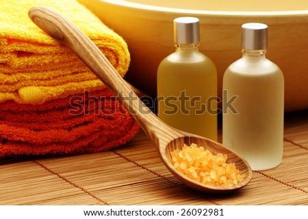 bath oil and bath salt with towels - body care