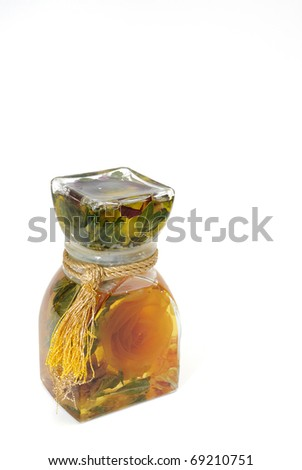 Bath oil with fermented rose flower in a glass bottle isolated on white with copy space.