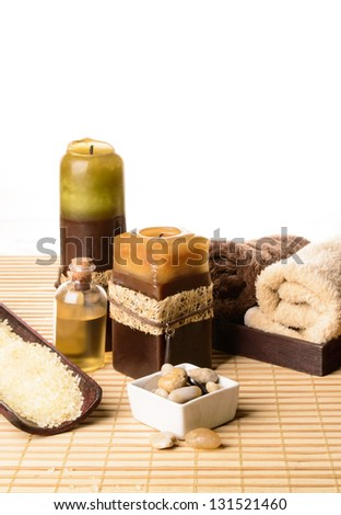 Bath oil with towels, candles and stones.Time for relaxation.