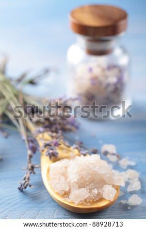 Bath salt in a wooden spoon and lavender