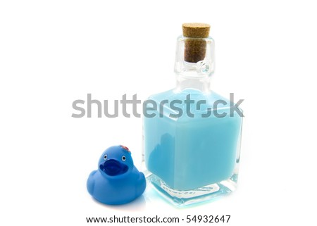 Bath soap with blue toy duck isolated over white