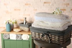 Bath towels in wicker basket, closeup