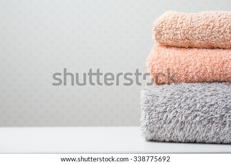 Bath towels of different colors on light background