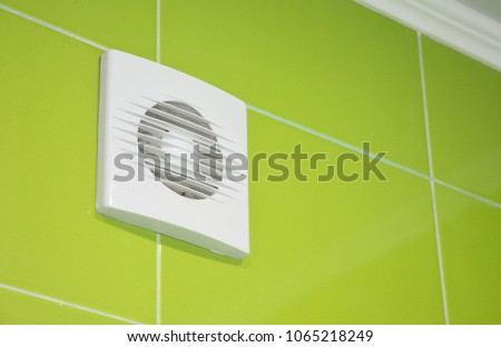 Bath vent fan with green tiles wall. White bathroom ventilation system. #1065218249
