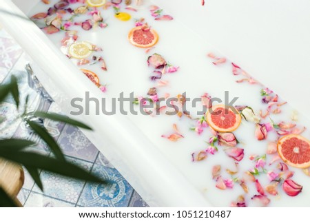 bath with milk and flowers