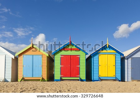 Bathing boxes in a beach against blue sky with copyspace - Shutterstock ID 329726648