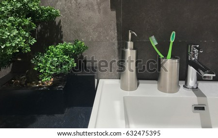 Bathroom Decorate with tree pot and toothbrush #632475395